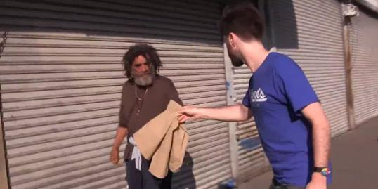 Photo: Still of man giving Abercrombie & Fitch clothes to the homeless (gkarber via YouTube)