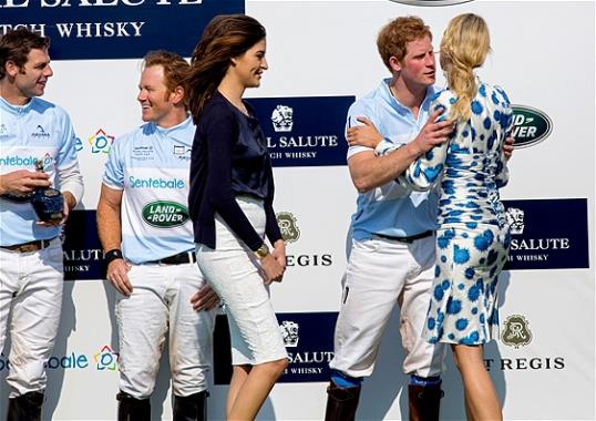 Photo: Britain's Prince Harry embraces model Karolina Kurkova after the Sentebale Royal Salute Polo Cup charity match (AP Photo/Craig Ruttle)