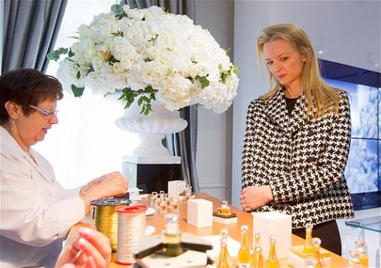 Assistant general manager Christian Dior Couture Delphine Arnault, right, looks a Dior perfume during his visit of