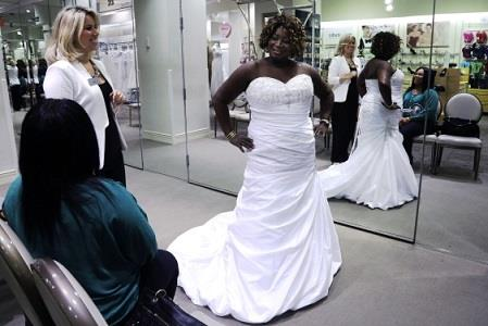 Photo: SherryLynne Heller trying on her wedding gown // AP