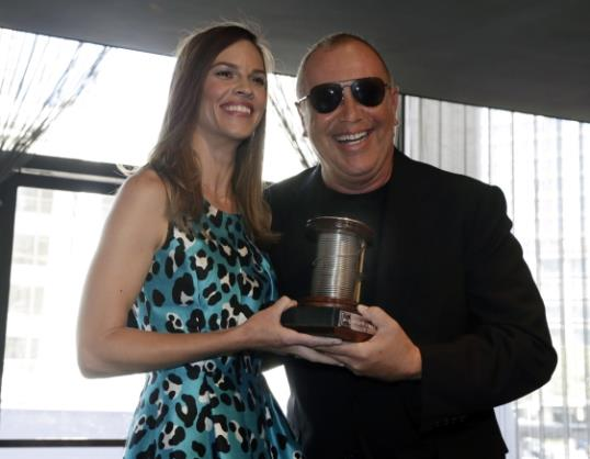 Photo: Hilary Swank and Michael Kors // AP Photo/Richard Drew