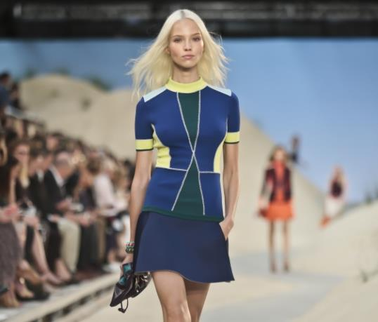 Fashion from the Tommy Hilfiger Spring 2014 collection is modeled on Monday, Sept. 9, 2013 in New York. (AP Photo/Bebeto Matthews)