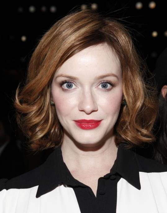Christina Hendricks attends the Carolina Herrera collection on Monday, Sept. 9, 2013, during Mercedes-Benz Fashion Week in New York. (Photo by Amy Sussman/Invision/AP)