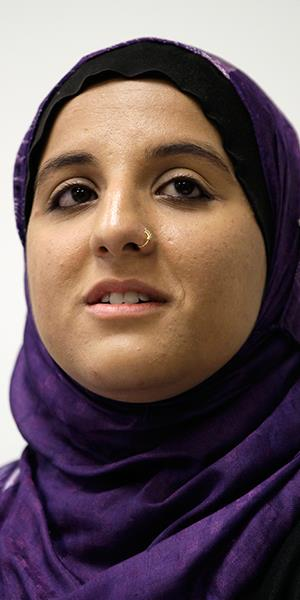 Hani Khan, a former stockroom worker for Abercrombie & Fitch Co. who was fired for refusing to remove her Muslim headscarf, listens to a question during a news conference in San Francisco on June 27, 2011 (Eric Risberg/AP)