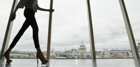 Sunday, Sept. 16, 2012 file photo, a model walks past a window with a view of St Paul's Cathedral in the background during the presentation of the Matthew Williamson Spring/Summer 2013. London Fashion Week kicks off on Friday Sept. 13, 2013. ( AP Photo/Alastair Grant, File)