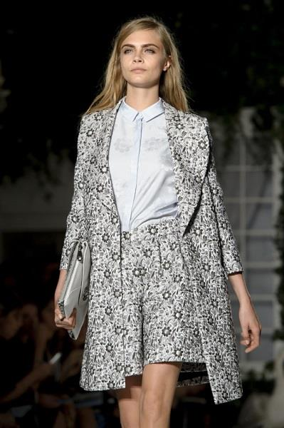 British model Cara Delevingne wears a design created by Mulberry during London Fashion Week Spring/Summer 2014, at Claridges Hotel in central London, Sunday, Sept. 15, 2013. (Photo by Jonathan Short/Invision/AP)
