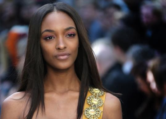 Model Jourdan Dunn wears a design created by Burberry Prorsum during London Fashion Week Spring/Summer 2014, at Kensington Gardens, central London, Monday, Sept. 16, 2013. (Photo by Joel Ryan/Invision/AP)
