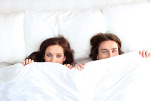 Photo: Couple in bed // Shutterstock