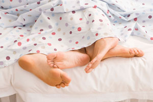 Photo: Couple under sheets // Thinkstock