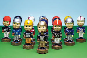 Photo: Football bobbleheads // Levi Brown