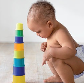 Baby with sorting blocks // Photo: Veer via Parenting.com