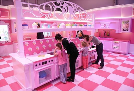 Photo: The pink kitchen is pictured with cupcakes in the Barbie Dreamhouse Experience near Alexanderplatz square in Berlin, Germany, Thursday May 16, 2013. (AP Photo/dpa, Jens Kalaene)