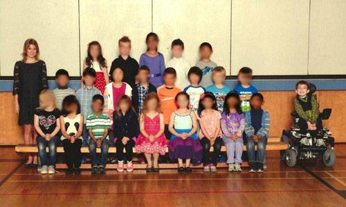 Photo: Class photo shows shows 7-year-old Miles Ambridge separated from the rest of his 22 classmates. / via Handout