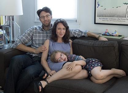 Photo: This June 17, 2013 photo released courtesy of Lauren Sandler shows, from left, Justin Lane, Lauren Sandler and Dahlia Lane at their home in the Brooklyn borough of New York. Sandler delves into the myths and misconceptions about singletons in a new book,