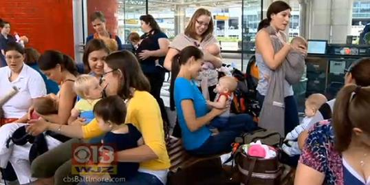 Still of moms holding a 'nurse-in' at BWI Marshall Airport to protest a breastfeeding incident involving American Airlines (CBS Baltimore, http://aka.ms/airport-nurse-in)