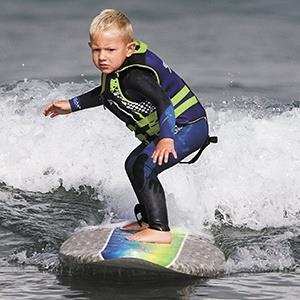 Triston Gailey, 3, surfs a few waves in Morro Bay, Calif. (Joe Johnston/San Luis Obispo Tribune/MCT /LANDOV)