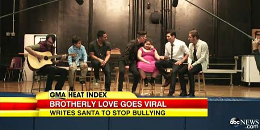 Video still of Ryan & Amber Suffern with Big Time Rush (Courtesy of GMA/ABC News)