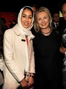 Photo: Manal al-Sharif and United States Secretary of State Hillary Clinton attend the TIME 100 Gala (Photo by Kevin Mazur/WireImage for TIME)
