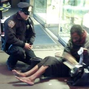 Photo: NYPD Officer Lawrence DePrimo bought new boots for a homeless man (Photo by Jennifer Foster as seen on NYPD's Facebook page)