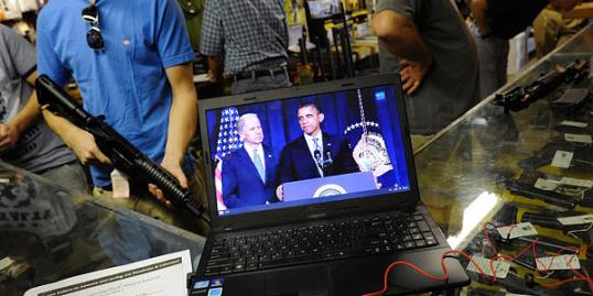 Photo: Gun shop customers in Sarasota, Fla., shop for weapons as they listen to announcement about gun control by Obama, January 16 2013 (Brian Blanco/Reuters)
