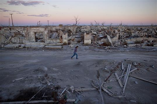 Photo: In this May 6, 2013 photo, former resident and tourist guide Norma Berg walks by a street in Epecuen, a village that once was submerged in water in Argentina.(AP Photo/Natacha Pisarenko)