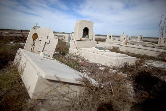 Photo: In this May 7, 2013 photo, tombs lay in the ruins of Epecuen, a village that was submerged in water in Argentina. (AP Photo/Natacha Pisarenko)