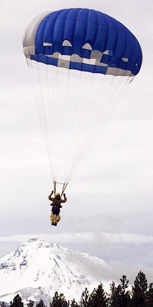 Photo: File photo of a smokejumper near Sisters, Ore.//Jack Smith/AP