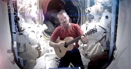 Photo: Astronaut Chris Hadfield recording the first music video from space Sunday May 12, 2013. The song was his cover version of David Bowie's Space Oddity. (AP Photo/NASA, Chris Hadfield)