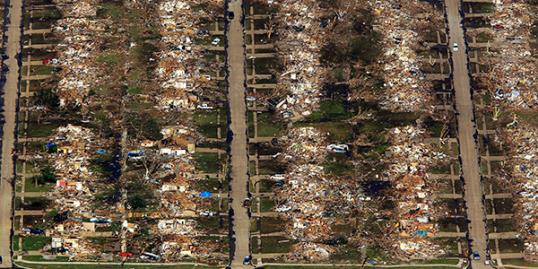 Photo: An aerial view of destroyed houses and buildings after a powerful tornado ripped through the area on May 21, 2013 in Moore, Oklahoma. (Photo by Benjamin Krain/Getty Images)