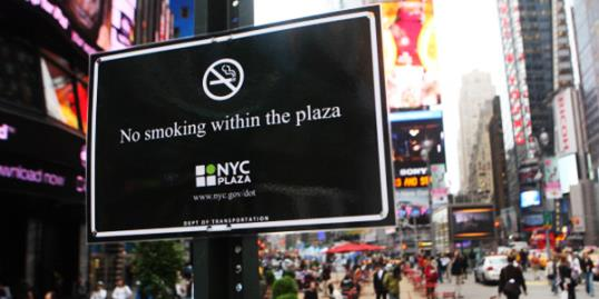 Photo: A no smoking sign is posted in the pedestrian plaza located in Times Square May 23, 2011 in New York City last month. A new smoking law took effect in New York City Monday, prohibiting smokers from lighting up in certain public places including parks and beaches. (Photo by Daniel Barry/Getty Images)