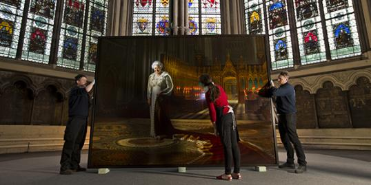File photo of a portrait of Queen Elizabeth II before it is positioned inside the Chapter House at Westminster Abbey on May 17, 2013 in London, England. A man has been accused of defacing the royal painting. (Photo by Dan Kitwood/Getty Images)