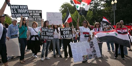 The Syrian American Forum holds a rally in front of the White House on Sept. 9 to protest against a strike on Syria (REX/Alyson Fligg)