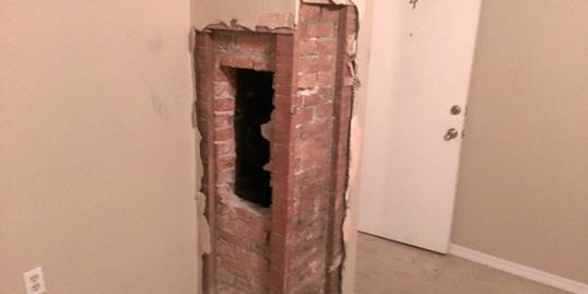 A man had to be cut out of this chimney in Tacoma, WA on Sept. 10 (KIRO 7 Eyewitness News via Facebook, http://aka.ms/stuck-in-chimney)