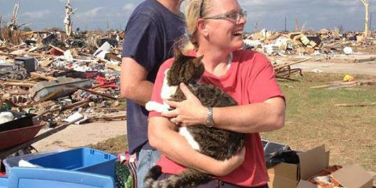 Photo: Jo Jumann holding her cat, Egor (Summer Hulme/Oklahoma Department of Agriculture Food & Forestry via Facebook