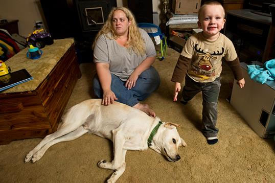 Brandi Mumaw sits inside her home in Woodstock, Va. with her son Jakob Heintzelman & their family labrador dog, Chance (Rich Cooley/Northern Virginia Daily/nvdaily.com)