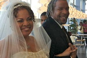 Photo: Julie Rodgers and Willie Pittman just after being pronounced husband and wife inside IKEA in College Park. (WTOP/Michelle Basch)
