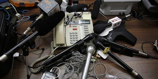Photo: Reporters' microphones surround a speakerphone as a transgender woman speaks on it after she won a legal ruling at Hong Kong&#8217;s top court allowing her to marry, in Hong Kong //Vincent Yu/AP 