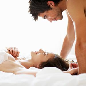Photo: Couple in bed / Fuse/Getty Images