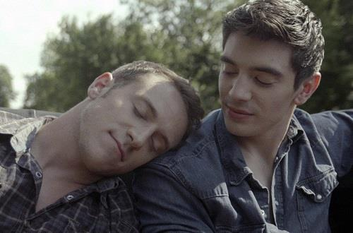 "This undated image provided by Digital Skylight shows musician Steve Grand, right, and actor Nicholas Alan appearing in this production still from the music video ""All-American Boy."" Grand's self-financed, gay-themed video has been viewed more than a quarter-million times since it was posted on YouTube July 2, 2013. (AP Photo/Digital Skylight, Brendan Leahy)"