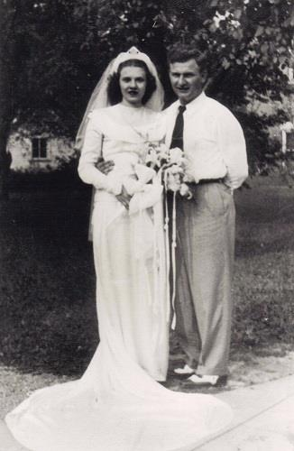 Harold and Ruth Knapke pose for a photo on their wedding day in St. Henry, Ohio, Aug. 20, 1947. (AP Photo/Knapke Family)