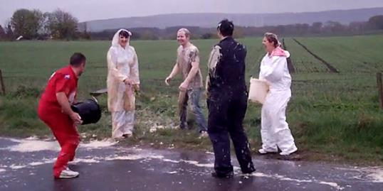 Video still of people participating in a 'Blackening of The Bride/Groom' ritual in Scotland (cairnside13 via YouTube, http://youtu.be/KDBNeOFm808)