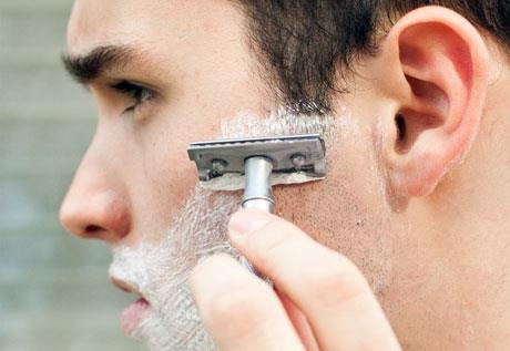 A man shaving // Photo: Courtesy of Lindsay Keys