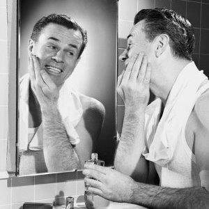 A vintage photo of a man shaving // Photo: Corbis
