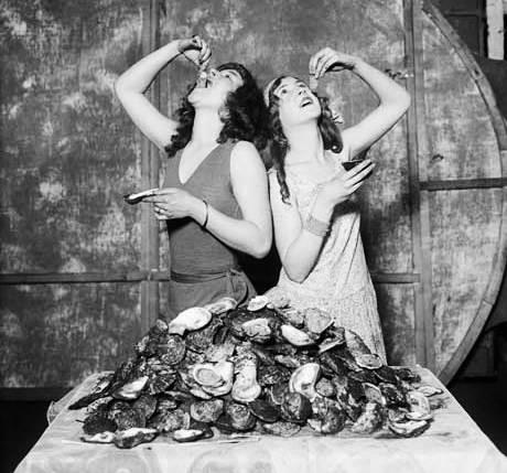Vintage photo of women eating oysters // Photo: Courtesy Corbis