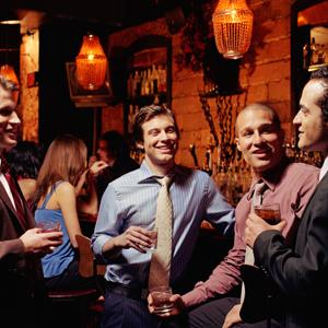 Men drinking and talking // PM Images, Getty Images