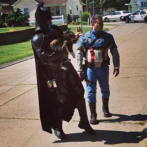 John Buckland, dressed as Batman, and Troy Marcum, dressed as Captain America,