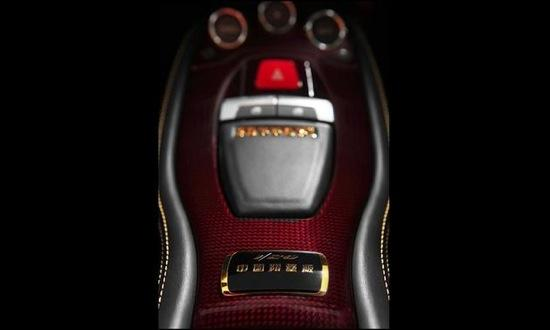 Chinese characters adorn the start button on the special edition 458 Italia. Photo by Ferrari.
