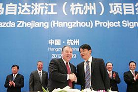 Ford agrees to build a new China plant in Hangzhou. (c) Ford