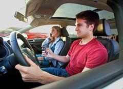 Texting, not wearing a safety belt, and one-hand steering increase driving risks. Photo courtesy of Consumer Reports.