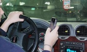 Thirty-nine states ban texting while driving. Photo courtesy of Autoweek.
